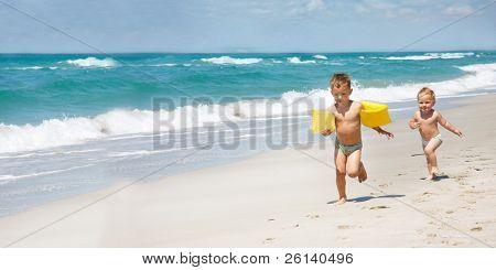 two kids running on beach