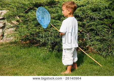 cute boy with butterfly net on natural background