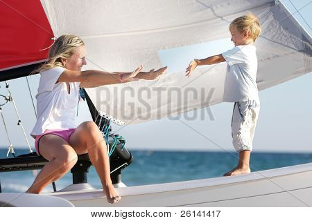 loving mother and son on board of sea yacht