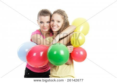 two smiling girls with balloons over white