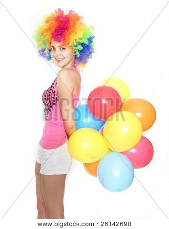 bright studio portrait of young happy woman with balloons