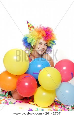 studio portrait of young happy woman with balloons
