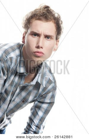serious young man looking straight over white