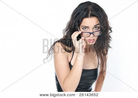 studio portrait of sad young attractive woman wearing glasses
