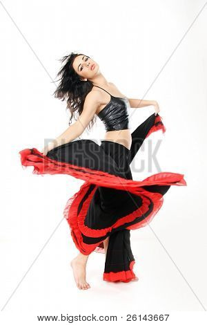 studio portrait of young attractive woman dancing flamenco