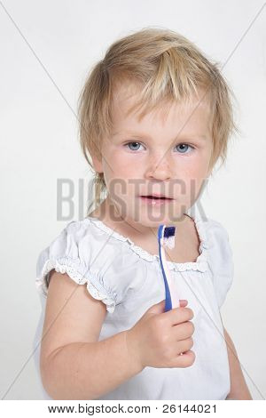 cute child with toothbrush over white