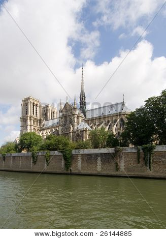 A classic, almost archetypal view of the Notre Dame and Ile de la CitŽ, seen from across the river Seine in Paris. The cathedral is basking in the sunlight