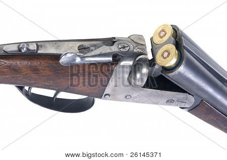 An old 16-gauge shotgun with two cartridges inserted into the chambers Clipping Path Included!