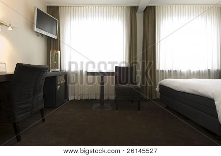 The interior of a stylish, business class hotel room, with all facilities available