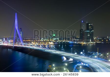 The Rotterdam Skyline with the famous Erasmus Bridge over the river Meuze at night