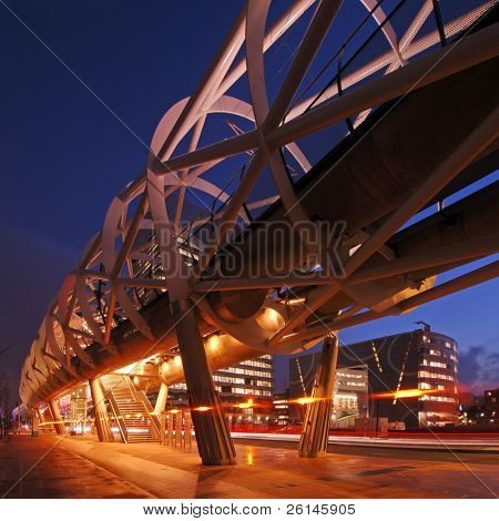 The modern looking, futuristic elevated tram line in the Hague, the Netherlands at night