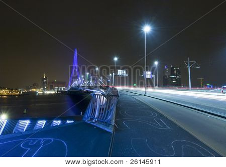 The famous Erasmus Bridge, approaching the steps leading to the boardwalk. The steps have drawings in chalk on them