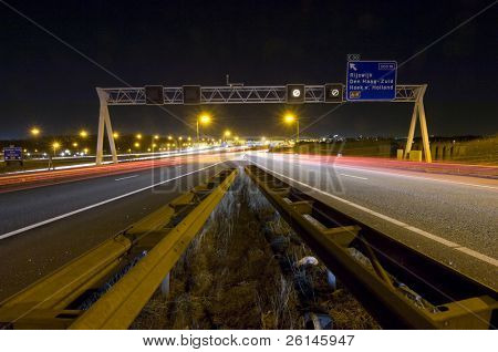 Two motorway lanes merging into one