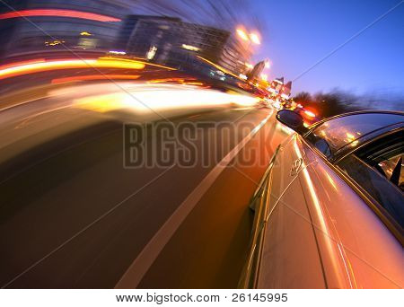 A car driving in the busy downtown streets, anticipating oncoming traffic