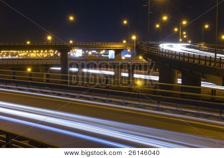 Traffic on an Highway Over pass or fly-over with motionblurred head lights