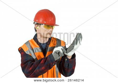 A worker, putting on protective gloves for safety reasons