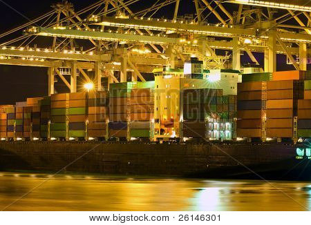 Close up of a container ship being unloaded