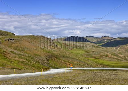 The single road around Iceland, the Number one, winding itself down through the remnants of dormant volcanoes towards the south coast near Reykjavik