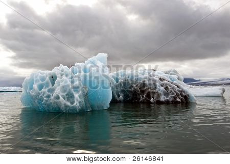 A melting iceberg in the famous Jokulsarlon glacier lake in Iceland, where the icebergs, originating from the Vatnajokull float. This location was used for various action movies.