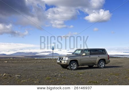 A parking lot in the middle of nowhere, with a view on the Icelandic Tundra and the huge Vatnajokull glacier along the Sprengisandur Highland Route