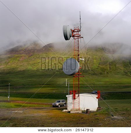 Moody Icelandic landscape with a communications station, illustrating global connectivity