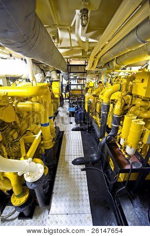 The engine room of a tugboat, with the various diesel engines for propulsion