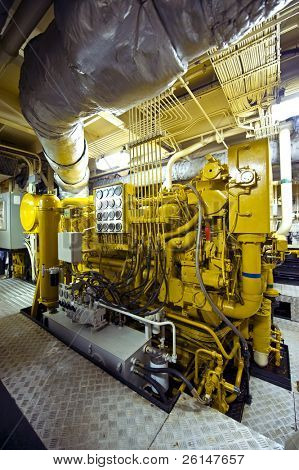 The huge and powerful diesel engine of a tugboat