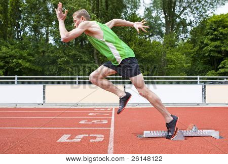Explosive start of an Athlete leaving the starting blocks on a sprint run
