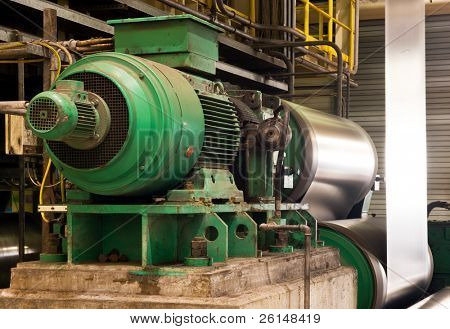Old electric engine powering a coil in a galvanized steel production line