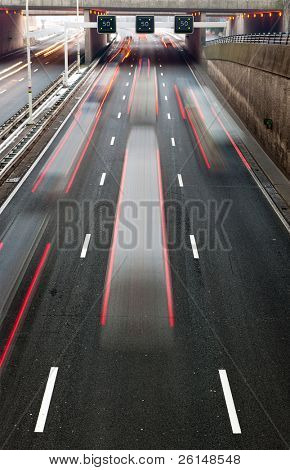 Busy traffic on a motorway with a speedlimitation ahead