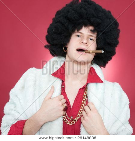 Arrogantly looking man, wearing a wig  and smoking a cigar.