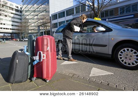A businessman discussing his fare with a taxi driver