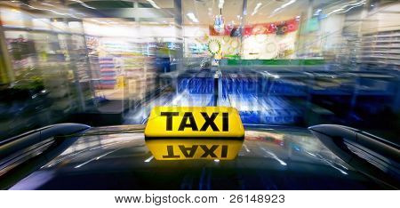 A taxi at high speed closing in on a night shop for a ram raid