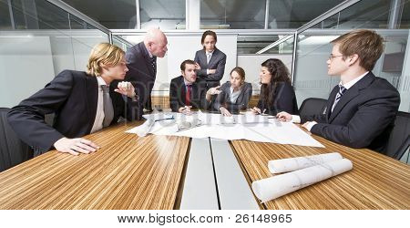 A group of six junior associates during a management team meeting with a senior manager