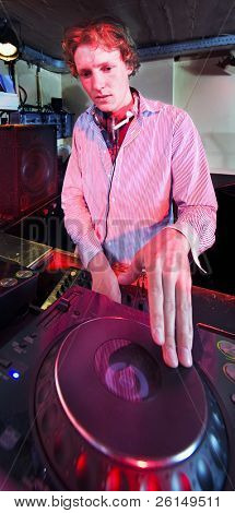 The DJ at work in a discotheque,