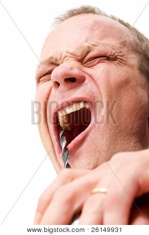Do-it-yourself dentist drilling in his own mouth with a power tool