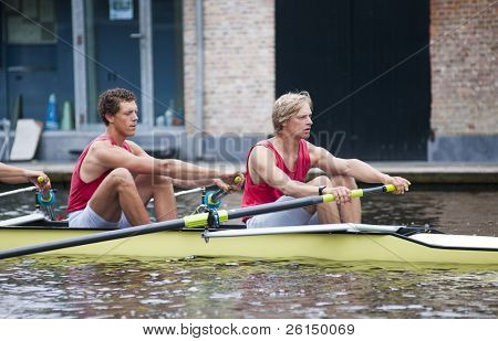Full concentration on the faces of oarsmen before the start of a regatta