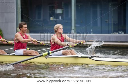 Oarsmen during the explosive first strokes of a rowing race
