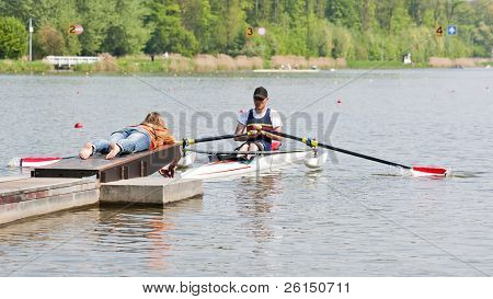 Disabled skiff rower, during the first strike of a rowing race, fresh from the start