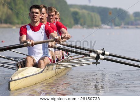 Coxed four rowing team during the first strokes after the start of a race