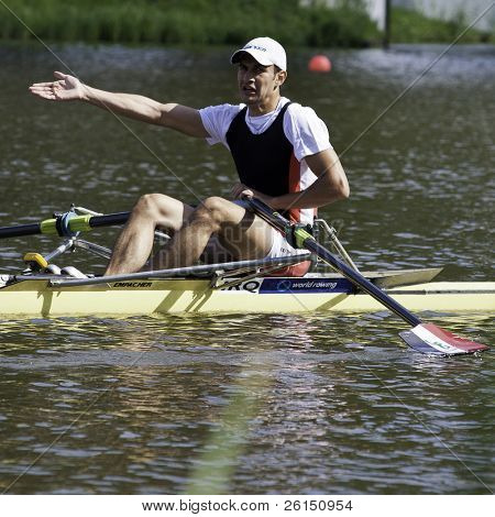 AMSTERDAM-JULY 22: Haily (Iraq single sculls) complains after the finish of his raceat the quarter finals of the world championships under 23.On July 22, 2011 in Bosbaan, Amsterdam, The Netherlands