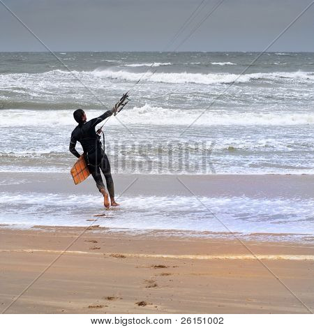 Kite surfer heading out to sea on a stormy day
