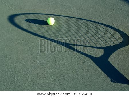 Shadowed racquet with a ball