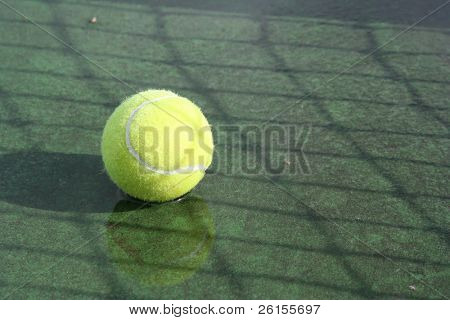 Rain Delay..  Tennis ball in a puddle