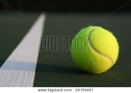 Tennis ball with opposite fading court line