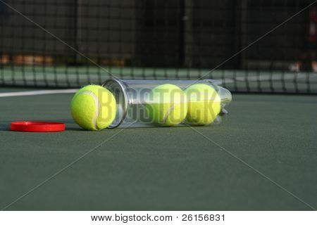 Open Canister of Tennis balls