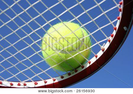 Tennis ball on a racquet
