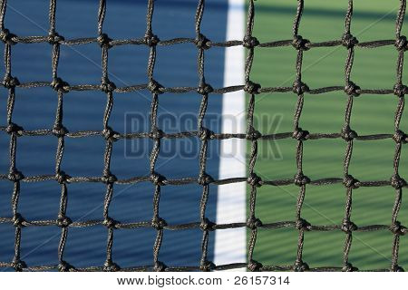 Tennis court net detail with court line in the background