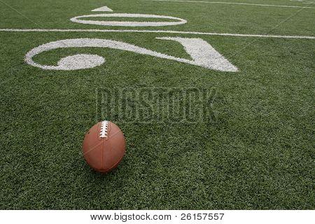 Football positioned near the twenty yardline