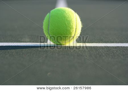 Tennis ball with room for copy in the foreground